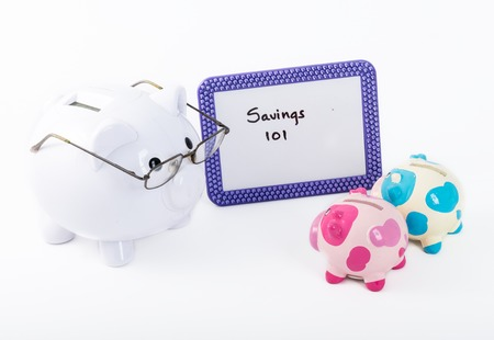 Cute concept of a piggy bank ready to teach how to save some money in life and business photo