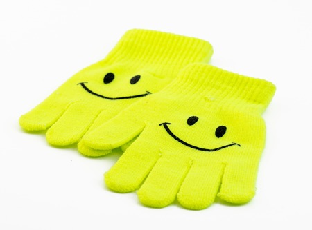 smiley: Pair of smiley winter gloves over a white background Stock Photo