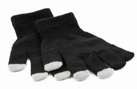 Set of winter gloves with the touch pad feature for modern electronic devices like pads and smart phones photo