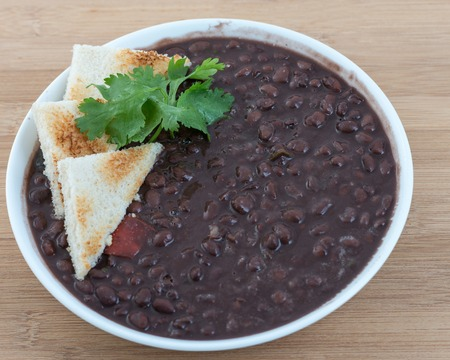 Delicious soup of black beans served the Cuban way. Traditional Cuban meal and an important source of vegetable protein in the island
