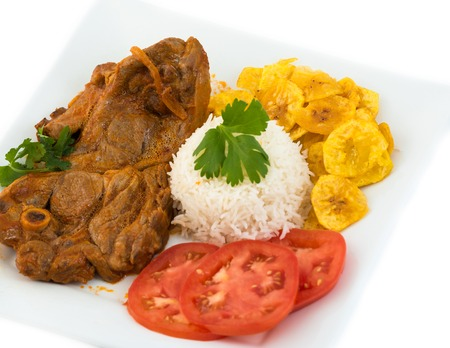 Angles of the traditional stewed lamb made and served the Cuban way