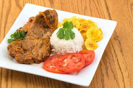 Angles of the traditional stewed lamb made and served the Cuban way photo