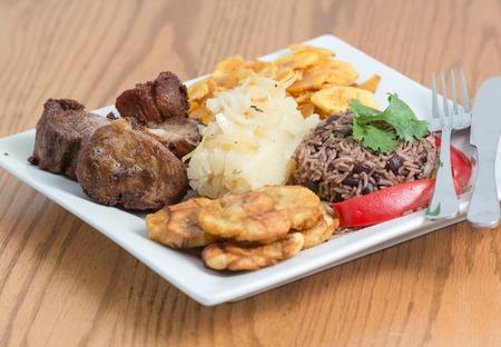 mojo: Deep fried pork, yukka or cassava plus congri rice all with salty green banana fries  Typical Cuban Meal