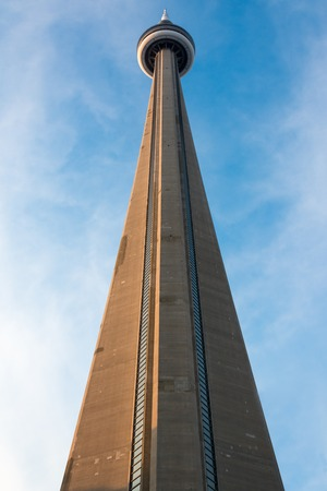 TORONTO,CANADA-MARCH 13, 2014: The CN Tower is a 553.33 m-high concrete communications and observation tower in Toronto. Built on the Railway Lands, it is worlds tallest free-standing structure