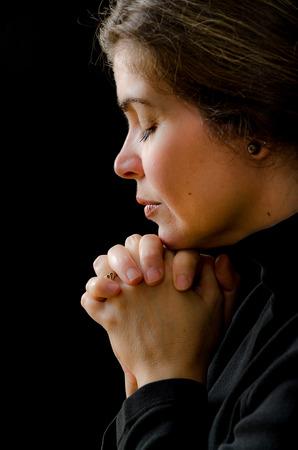Hispanic woman praying to his saviour in heaven