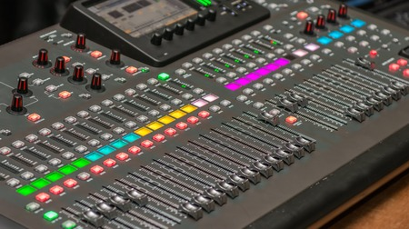 jockey: Sound console detail. DJ and audio operator equipment to produce a musical production