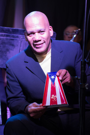 80 s: TORONTO,CANADA-MARCH 28, 2014  The popular salsa group El Gran Combo de Puerto Rico performs in Toronto celebrating their 52 anniversary of artistic life and also launching their new CD Editorial