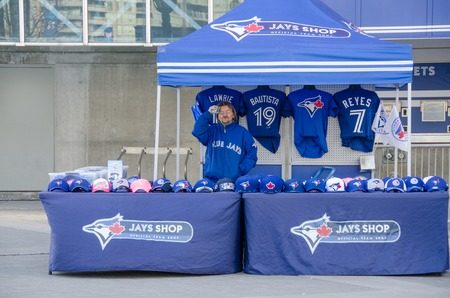 memorabilia: TORONTO,CANADA-APRIL 9,2014: Selling Blue Jays memorabilia outside the stadium. The Toronto Blue Jays are a professional baseball team located in Toronto,Canada. Members of the Eastern Division of MLB