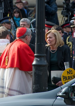 Toronto, Canada-April 16, 2014  Cardinal Thomas Collins and Christine Elliott widow of Flaherty Scenes of the State Funeral for Jim Flaherty, former Minister of Finace of Canada, held at St  James Cathedral in Toronto Editorial