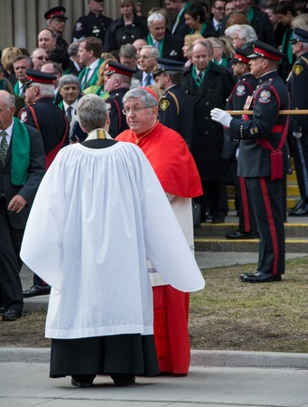 elite: Toronto, Canada-April 16, 2014  Cardinal Thomas Collins from Canada Scenes of the State Funeral for Jim Flaherty, former Minister of Finace of Canada, held at St  James Cathedral in Toronto Editorial