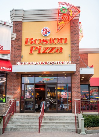 franchises: NIAGARA FALLS, CANADA-APRIL 18, 2014  Boston Pizza, also known as BP and The Gourmet Pizza, is a Canadian-based restaurant chain that owns and franchises locations in Canada, United States and Mexico