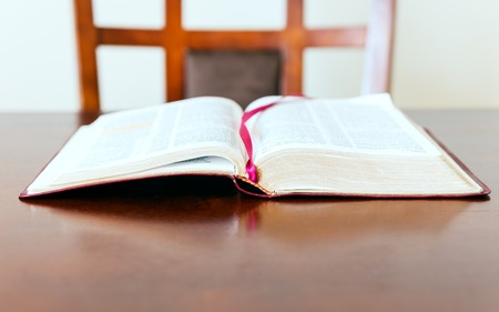 word of god: Open Bible over a desk or table. Open word of God waiting for the pastor or believer. The need of coming back to the word of God as source of guidance.
