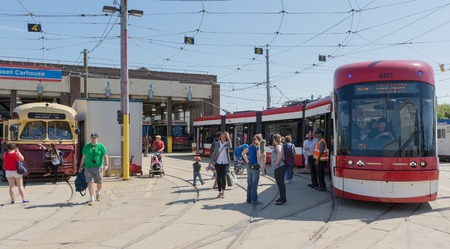 smoother: Toronto,Canada-May 24, 2014  Bombardier new streetcars were presented to the public for the first time by the TTC  The new vehicles will start do their routes in August 2014 as planned by the city