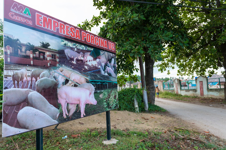 enlarged: SANTA CLARA,CUBA-JUNE 28,2014: Entrace to the Empresa Porcina a Government company for raising pigs and providing them as meat for tourism and grocery stores.