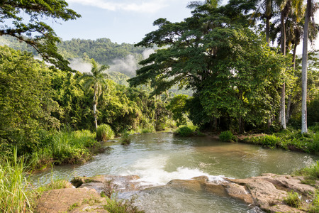 Beautiful waterfalls or cascades in El Nicho, Cuba. The place used to be a military base and now is open for eco tourism. Stock Photo
