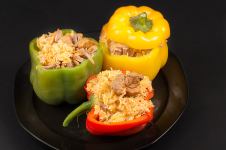 rican: Cuban Cuisine: Bell Peppers Stuffed with Yellow Rice and pork meat. Creative presentation of a popular dish for dinner or lunch in the Caribbean Island