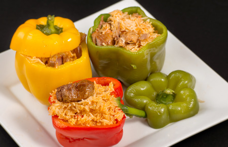 Cuban Cuisine: Bell Peppers Stuffed with Yellow Rice and pork meat. Creative presentation of a popular dish for dinner or lunch in the Caribbean Island photo