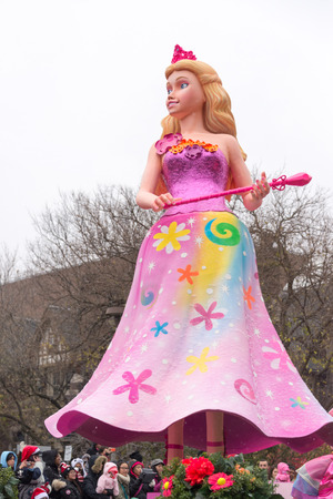 barbie: Toronto,Canada-November 16, 2014: The Toronto Santa Claus Parade is a Santa Claus parade held annually in mid-November in Toronto, Ontario, Canada. More than a half million people attend the parade every year. The televised parade starts after noon and la