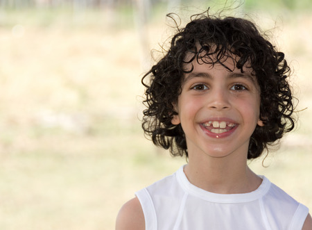eight years old: Cute eight years old Hispanic boy smiling with shallow depth of field in the countryside