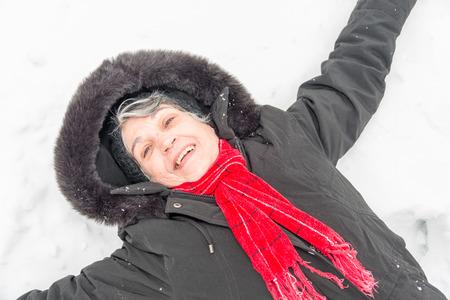 cold: Latin senior lady having fun Stock Photo