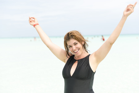 40 to 45 years old: An attractive middle age woman enjoys a tropical beach