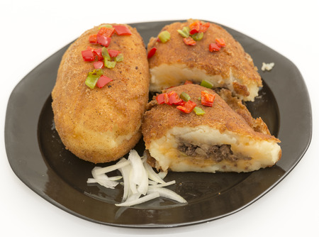 Cuban cuisine: delicious plate of stuffed potatoes made in the traditional Cuban way