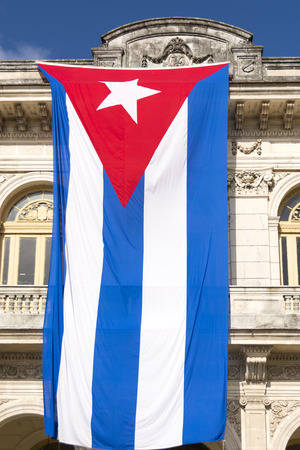 Large Cuban flag hanging in a public building photo