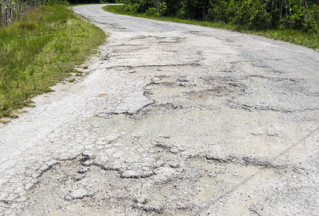 well maintained: Road full of potholes, way in bad conditions, not well maintained road Stock Photo
