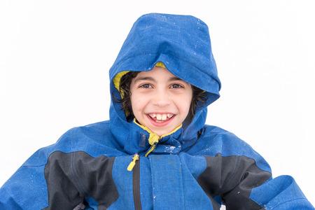 frigid: Child boy portrait in a frigid Winter day with white fresh snow as background