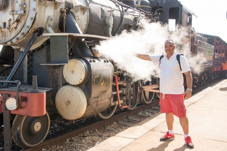 Tourist steam locomotive working between the former sugar mill of Marcelo Salado and the city of Remedios.  Steam locomotive were the most common way of getting sugar cane to the mills before the Revolution. In time, they were substituted for Russian Zyl  photo