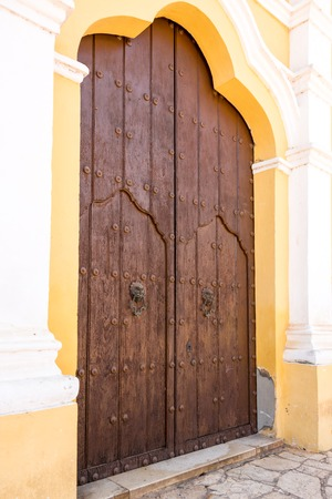 17th: Old colonial vintage main door of the San Juan Bautista or Saint John the Baptist church in Remedios which is a Cuban National Monument
