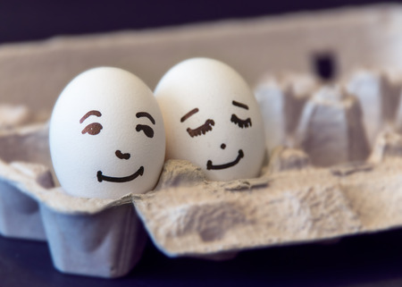 Concept of a couple in love, two eggs with painted faces illustrate the concept of a couple in love