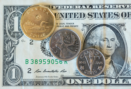 money matters: The Canadian dollar or loonie is under pressure amid weak oil prices and a strengthening U.S. currency.  Today, the loonie dropped to 78.39 cents for a U.S dollar the lowest in a many years. Stock Photo