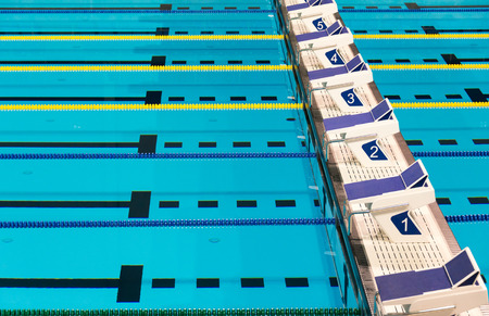 Beautiful sports competition sport competition swimming pool lanes in a clear transparent blue water facility Stock Photo