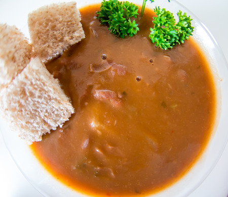 beans soup: Cuban cuisine: red kidney beans soup surfce taken with wide angle lens and white background.
