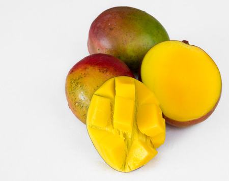 imperfect: Realistic approach to tropical fruits: three  imperfect ripe mangos over white background not isolated Stock Photo
