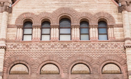 variance: Architectural details of the Old City Hall which is a variance of the Romanesque Revival called Richardsonian Romanesque. The building is part of Toronto heritage and a major tourist landmark