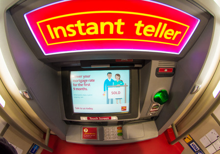 td: TORONTO,CANADA-APRIL 4,2015: CIBC ATM machine outside a branch. The Canadian Imperial Bank of Commerce , commonly CIBC, is one of Canadas chartered banks, fifth largest by deposits.