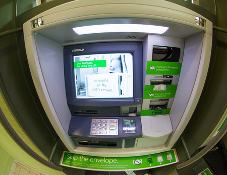 bank branch: TORONTO,CANADA-APRIL 4,2015: TD bank ATM, discard the envelope policy.The Toronto-Dominion Bank is a Canadian multinational banking and financial services corporation headquartered in Toronto.