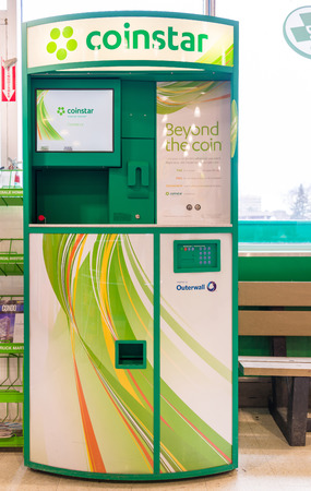 TORONTO,CANADA-APRIL 4,2015: Coinstar machine in a grocery store. Coinstar offers a network of self-service kiosks that allow consumers to exchange coins or gift cards into cash.