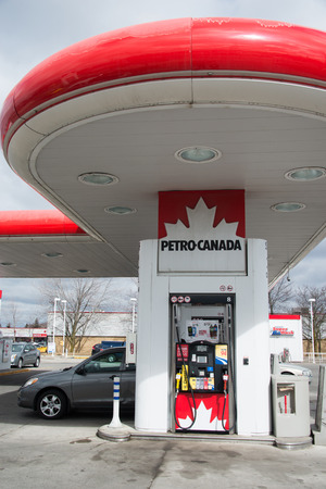 natural gas prices: TORONTO,CANADA-APRIL 4,2015: Petro Canada gasoline pump. Petro-Canada is a retail and wholesale marketing brand of Suncor Energy. Until 2009, it was a crown corporation headquartered in Calgary.