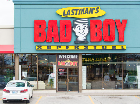mel: TORONTO,CANADA-APRIL 4,2015: Lastmans Bad Boy Store facade. This succesful furniture store chain was founded by former Toronto Mayor Mel Lastman who led the city till 2003.