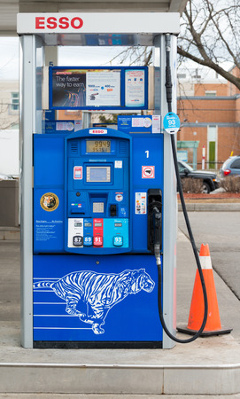 phonetic: TORONTO,CANADA-APRIL 4: 2015: Esso gas pump in station. Esso is an international trade name for ExxonMobil The name is a phonetic version of the initials of the pre-1911 Standard Oil