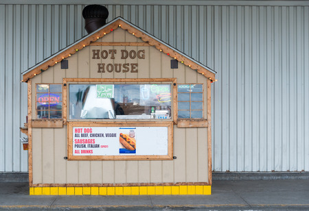 owned: TORONTO,CANADA-APRIL 4,2015: Hot dog vendors representant of small family owned private business. Their success comes from being a cheap eat in such large city. Since 2012, their menu has expanded.