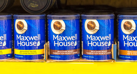 maxwell: TORONTO,CANADA-APRIL 4,2015: Maxwell House coffee cans in store shelf.Maxwell House is a brand of coffee manufactured by a like-named division of Kraft Foods.