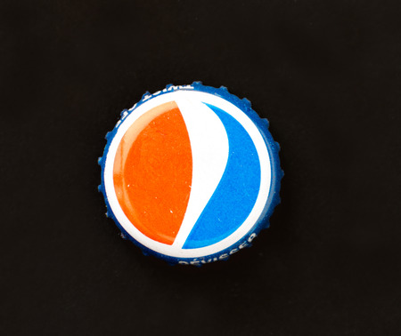brads: TORONTO,CANADA-APRIL 4,2015:Pepsi Cola Cap . Pepsi is a carbonated soft drink that is produced and manufactured by PepsiCo. Created in 1893 and introduced as Brads Drink, it was renamed as Pepsi-Cola