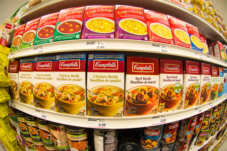 convenient store: TORONTO,APRIL 4,2015: Campbells soup in store shelf. Campbell Soup Company, is an American producer of canned soups and related products. Campbells products are sold in 120 countries around the world