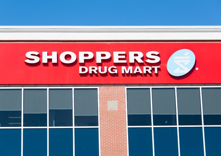 prescription drugs: Shoppers drug mart sign; Shoppers Drug Mart Corporation is Canadas largest retail pharmacy chain and it was bought recently by Lowblaws. Editorial