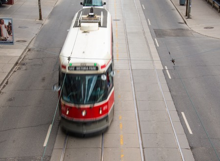 12 oclock: Old vintage Toronto streetcar in Queen St. in the downtown district of the North American multicultural city