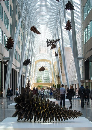 first sight: Colonization an art project by Floyd Elzinga in Allan Lambert Galleria to celebrate Earth Day. The work consist of 21 pinecones made of solid steel which stun visitors at first sight with their stature, shape, and size � ranging from 24 inches to over 9 Editorial